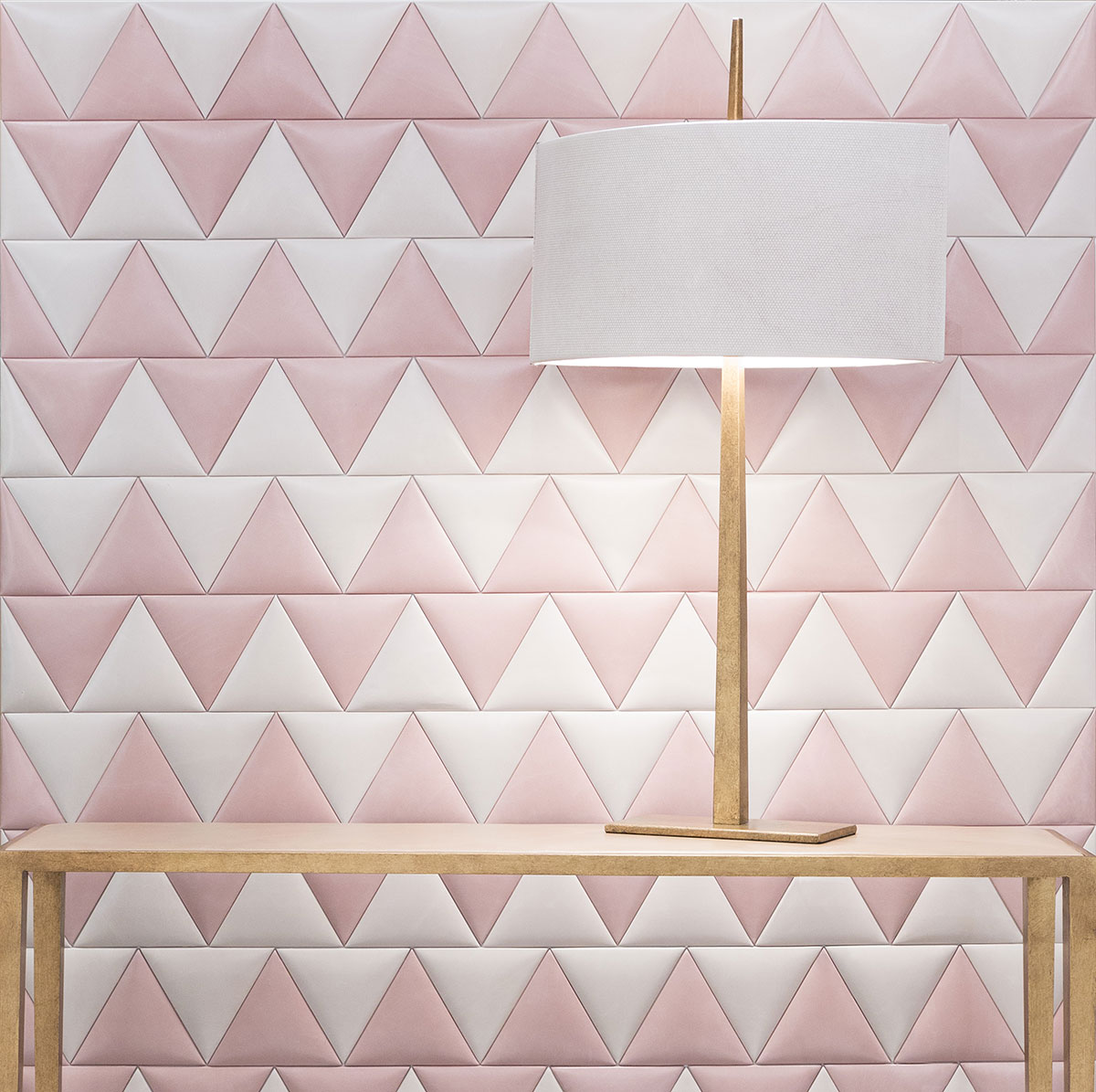 Pink is no longer sweet and innocent-looking but rather, sleek and sophisticated with this metallic leather wall covering. Image credit: TATUM