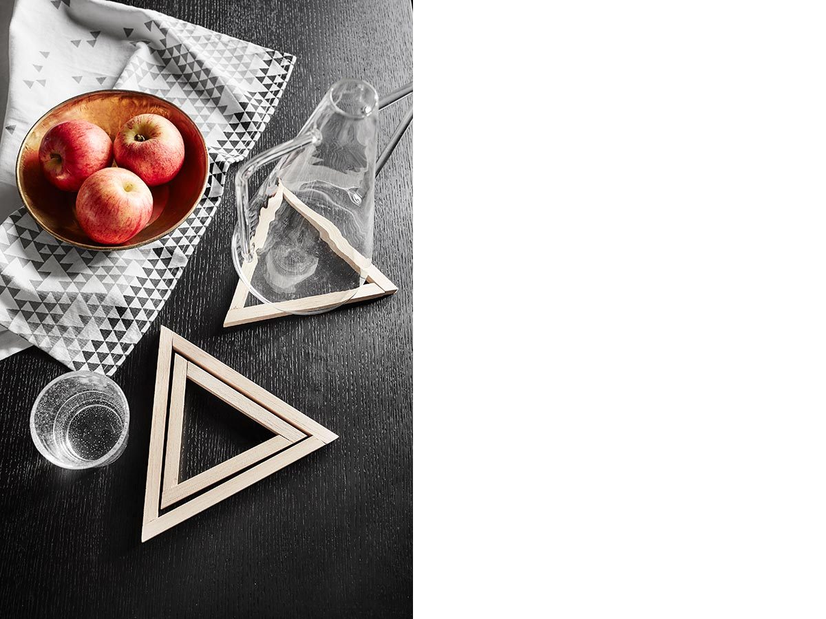 Featuring Lux black and gold bowl, $35.95, Triangles kitchen towel, $13.95, Roma Giorgio cone-shaped carafe, $79.95 and bubble tail mouth-blown glass, $15.95, all from HomesToLife.